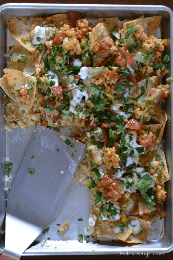 Very Vegetarian Nachos made with my Mexican brown rice topping. It's so NOT boring...my mom says it's one of her favorite flavor and texture combos! thekitchengirl.com