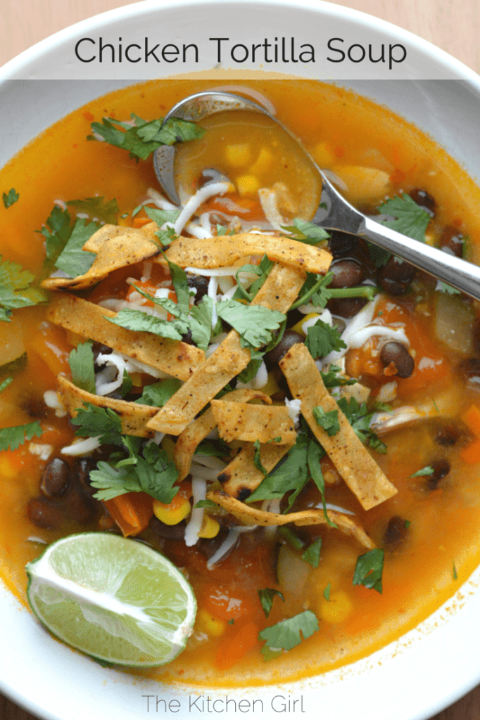 Easy Chicken Tortilla Soup made with rotisserie chicken, tomatoes,black beans, corn, tortilla strips, lime, and cilantro. Naturally gluten free and dairy free. #chickentortillasoup #rotisseriechicken #30minutemeal #tortillasoup #mexicanfood #blackbeans #texmex