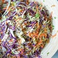 Meal prep and eat clean! This Asian slaw quinoa salad has ALL the produce and a Sesame Ginger Vinaigrette #asiansalad #asianslaw #sesame #orientalsalad #mealprep #glutenfree #choppedsalad #vegan #asiandressing #sesamedressing