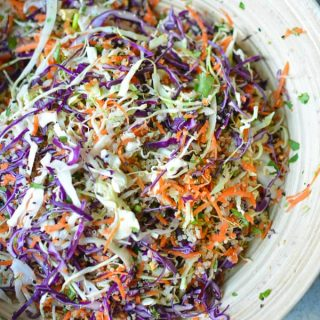 Meal prep and eat clean! This Asian slaw quinoa salad has ALL the produce and a Sesame Ginger Vinaigrette #asiansalad #asianslaw #sesame #orientalsalad #mealprep #glutenfree #choppedsalad #vegan #asiandressing #sesamedressing