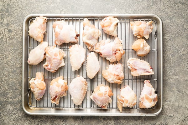 raw chicken wings on cooking grid sheet pan