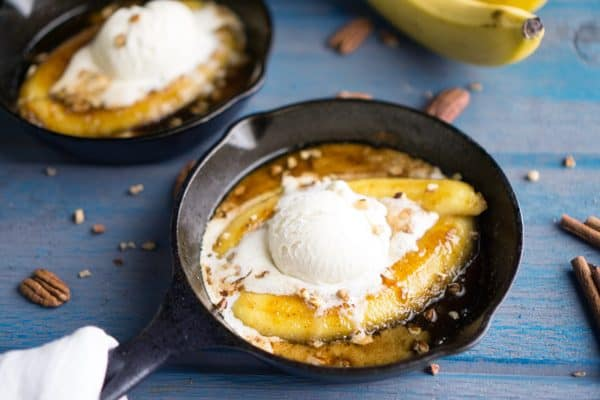 New Orleans Bananas Foster dessert recipe. Scrumptious, date night dessert with caramel sauce, bananas, pecans, and vanilla ice cream. #bananasfoster #neworleans #fattuesday #mardigras