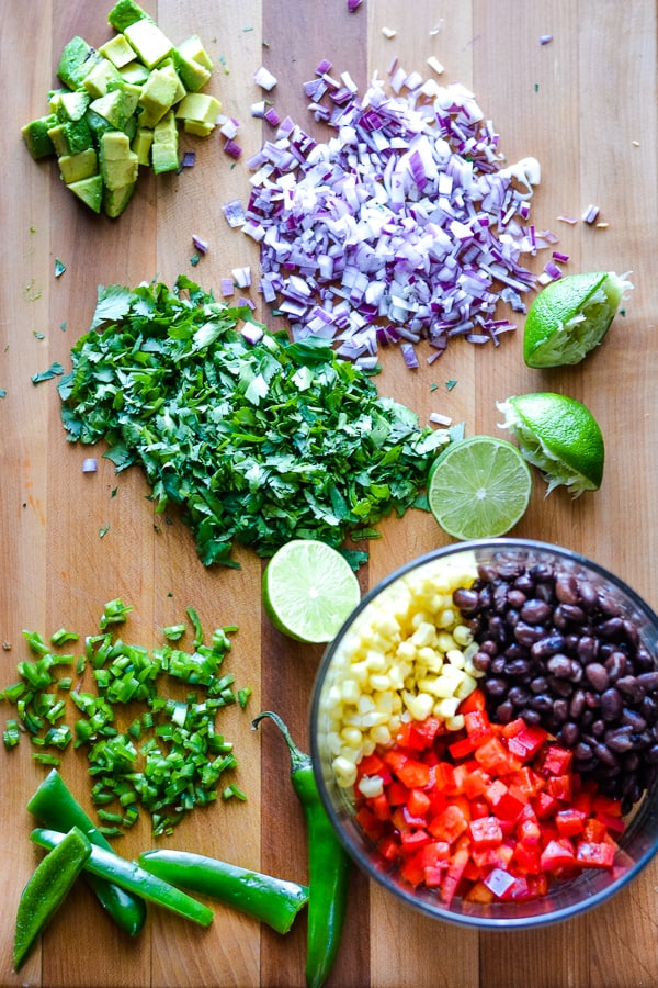 chopped black bean salsa ingredients on brown cutting board