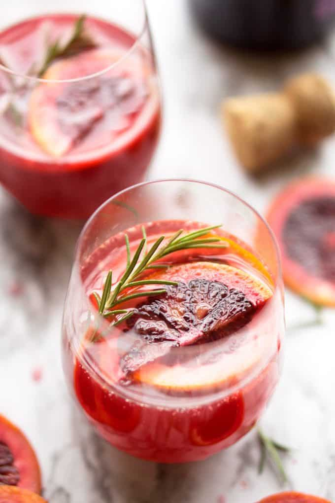 Mimosa recipe with blood orange is an elegant, ruby red cocktail for any daytime occasion #mimosa #bloodorange #cocktail #sparklingwine #prosecco #brunch #cocktail #champagne #holidaycocktail #Christmas #Thanksgiving