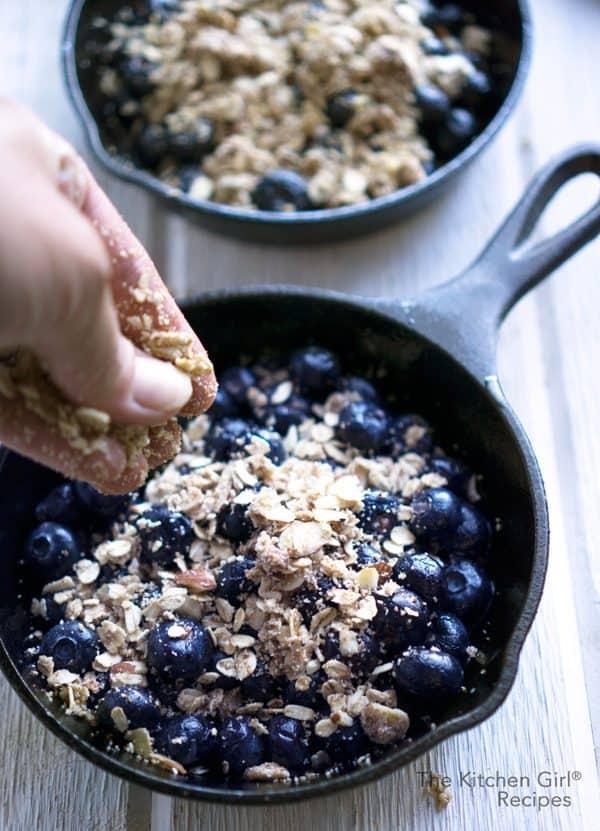 Secretly healthy vegan blueberry crisp recipe made with fresh or frozen blueberries and a crisp, oat and almond topping #blueberrycrisp #blueberries #summer #fruitcrisp #berrycrisp #glutenfree #vegan #almondmeal