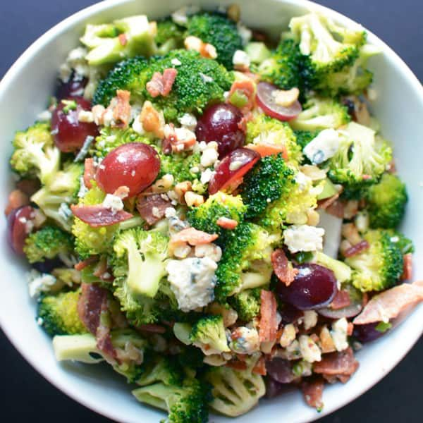 Broccoli salad with bacon, blue cheese, and grapes in honey mustard vinaigrette #broccolisalad #broccolibacon #honeymustard #partyfood #bacon #bluecheese #lowcarb #grapes