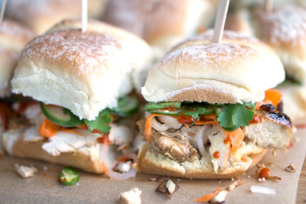 side view view of banh mi sandwiches on parchment paper background