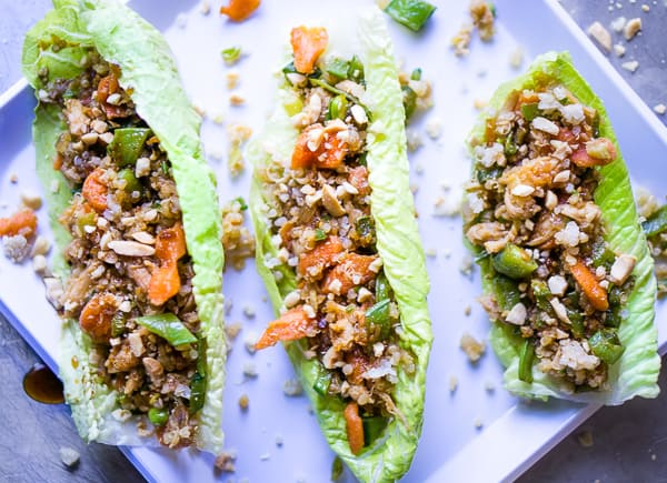 chicken lettuce wraps on white plate