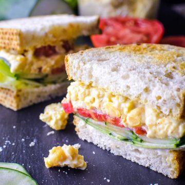chickpea salad sandwich on black slate