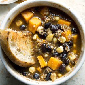 Chipotle seasoned Quinoa Sweet Potato Black Bean Chili is perfect for weekly meal prep and weekend parties! #vegan #veganchili #glutenfree #quinoa #mealprep #meatlesschili #blackbeans #sweetpotato
