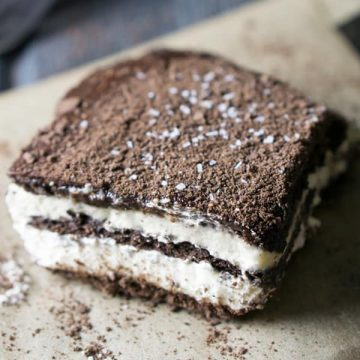 Square piece of chocolate eclair icebox cake on parchment paper