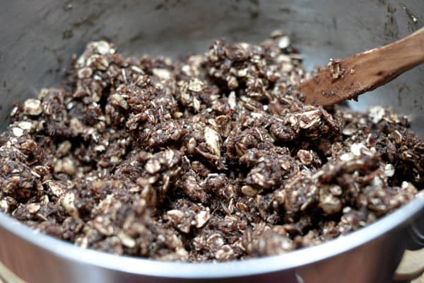 energy bar mixed in bowl with wooden spoon