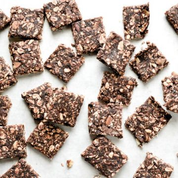 chocolate energy bar squares on parchment paper