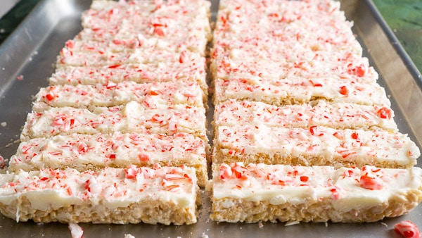 rice crispy treats with white chocolate and peppermint candy cane coating