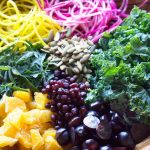 Eat clean all winter with Citrus Kale Beet Winter Rainbow Salad in Bragg apple cider vinaigrette on thekitchengirl.com #bragg #applecidervinegar #superfood #wintersalad #buddhabowl #powerbowl #nourishbowl #vegansalad #mealprep #mealplan #spiralizer #eatclean #veganrecipe