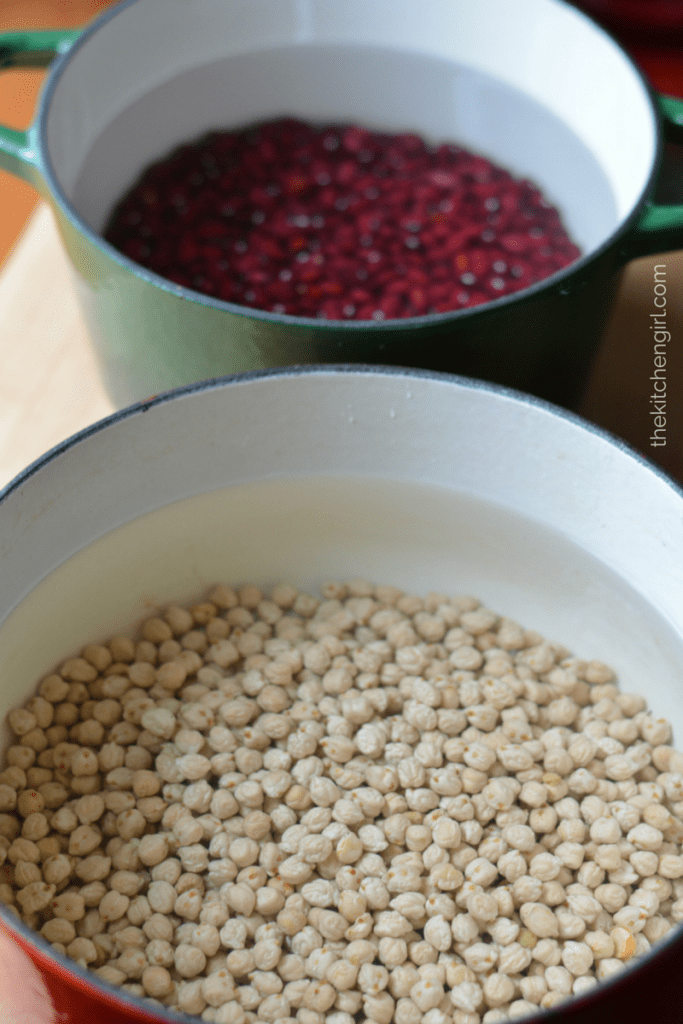 dried beans in dutch ovens filled with water