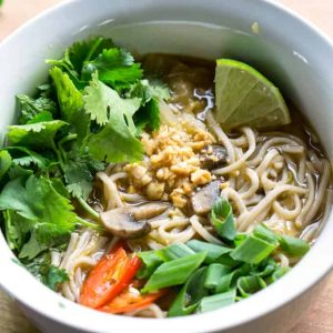 Feed a cold with Feel Better Pho. Easy, 15 min, Vegan, Asian-inspired soup on thekitchengirl.com #asianpho #pho #coldandflu #coldsymptoms #easysoup #vegansoup #getwellsoup