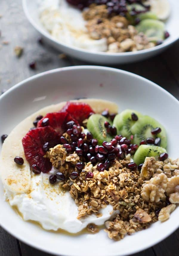 Fresh fruit, homemade granola, and greek yogurt breakfast bowls #greekyogurt #vegetarian #glutenfree #breakfastbowl #pomegranate #bloodorange #granola