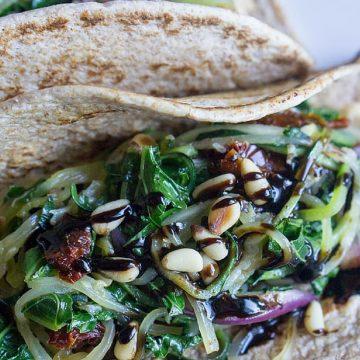 Garden Zoodle Veggie Wrap - Vegan sandwich wrap with sautéed zucchini, kale, tomatoes, folded in flatbread with hummus & balsamic drizzle. thekitchengirl.com