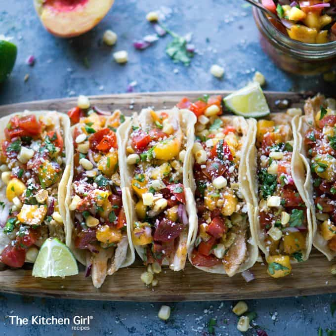 BEST summer tacos! Grilled Chicken Tacos with Peach Salsa make your taste buds literally dance! It's healthy Mexican food! thekitchengirl.com #healthytacos #grilledchicken #peachsalsa #tacos #glutenfree #healthymexicanfood #salsafresca