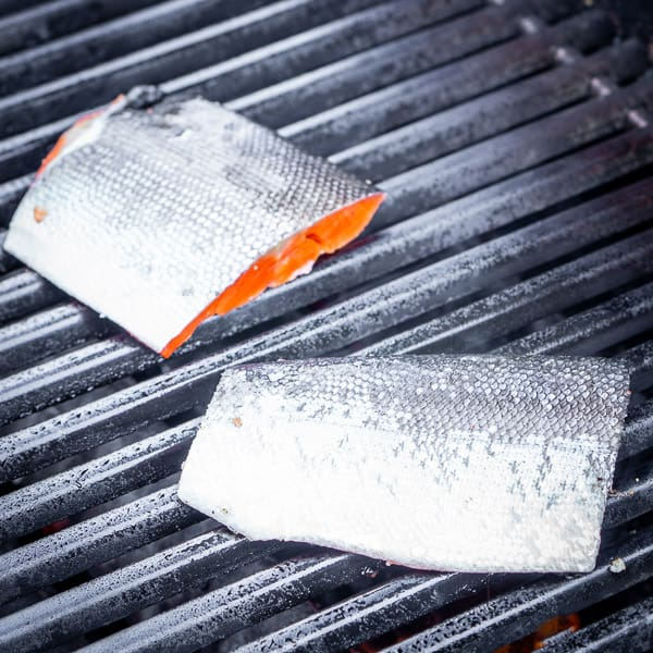 Fresh salmon fillets being grilled flesh side down and skin side up