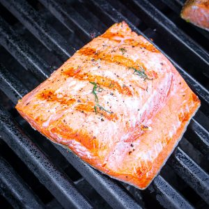 Grill-marked salmon fillet on the grill'