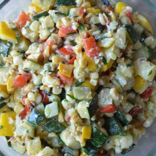 Too much zucchini? Grab this zesty, savory Grilled Zucchini Corn Salad with Feta Dressing. Vegetarian, GF, easy, and fast! thekitchengirl.com