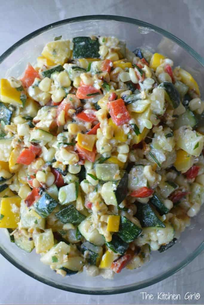 Grilled Zucchini Corn Salad with Feta Dressing happens when you have too much zucchini. This zesty, savory salad is vegetarian, gluten-free, and super easy! thekitchengirl.com