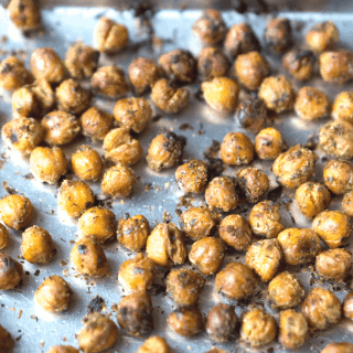 Crispy, zesty, snack or salad topping with fiber & protein! Herb Roasted Chickpeas #vegan #glutenfree #vegansnack #bakedchickpeas #healthysnack #bakedgarbanzos