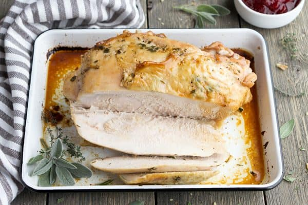 How to cook a turkey breast (bone-in). Herb Roasted Turkey Breast is a hassle-free turkey recipe for winter holidays that cooks in 1 hour! #roastturkey #roastedturkey #Thanksgiving #Christmas