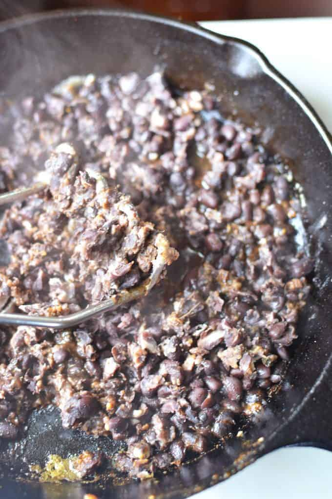 How to make refried black beans from canned whole beans. Sooo easy and healthy! #glutenfree #healthymexican #meatless #cincodemayo #partyfood #vegan #refriedbeans