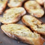 Make crostini with a baguette, rustic loaf, or ciabatta for the perfect bruschetta or dipping tool. You only need olive oil and bread #crostini #partyfood #bruschetta #toastpoints #appetizers #partyfood #horsdoeuvres