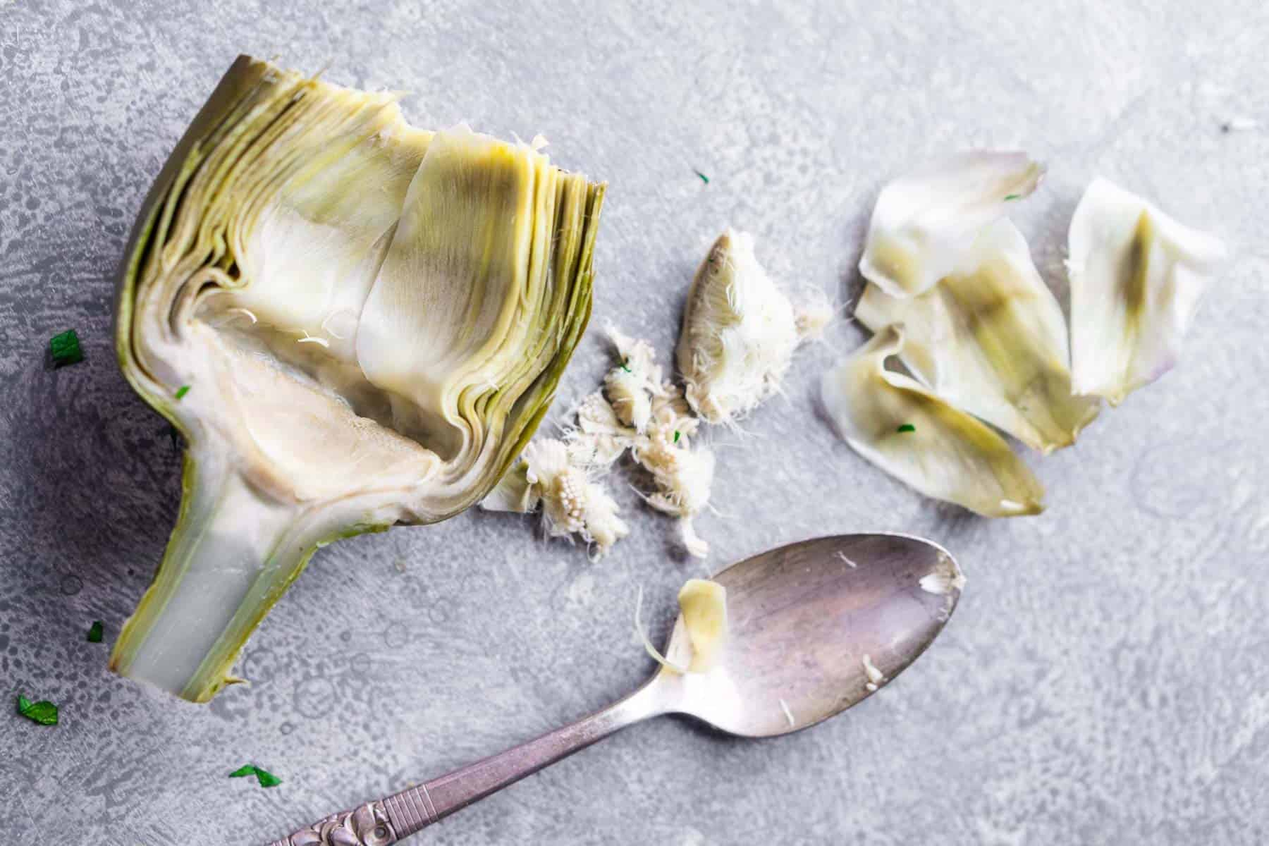 Whole steamed artichoke choke removed removed with a spoon