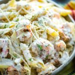 creamy shrimp pasta in bowl with multicolored napkin
