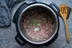 sauteed beef and seasonings in the Instant Pot