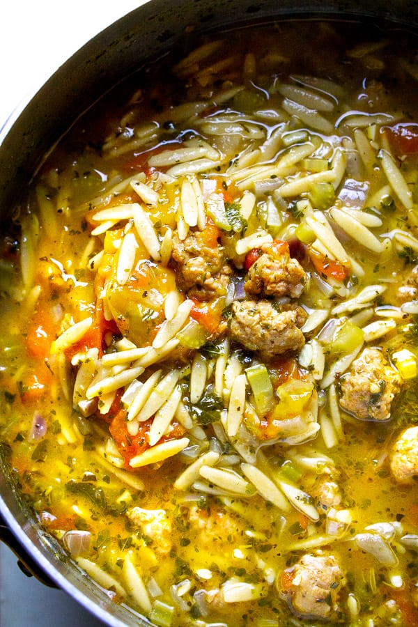 Italian sausage soup with orzo in soup pot