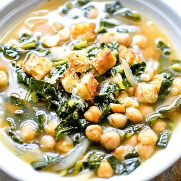 kale chickpea soup in white bowl