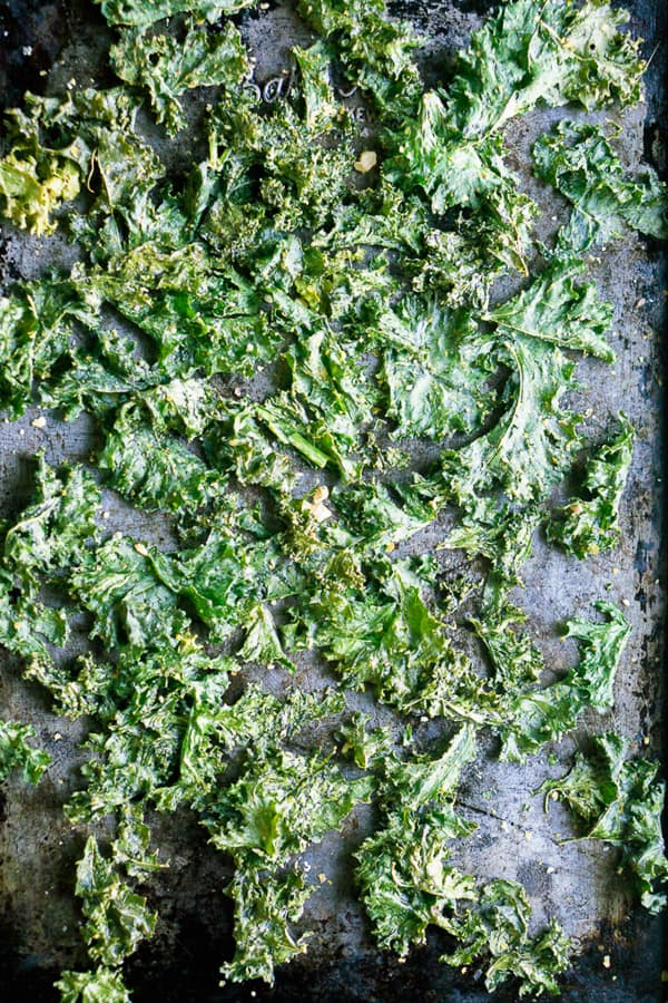 overhead view of kale chips on sheet pan