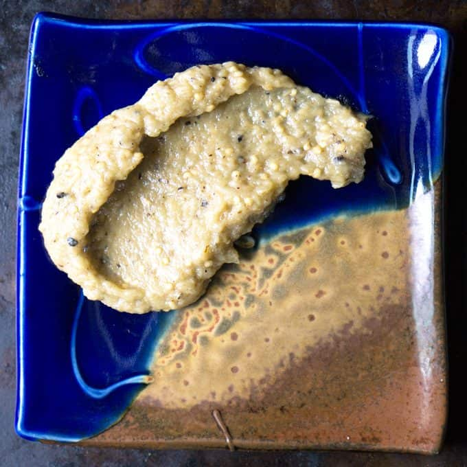 Greek eggplant dip spread on blue plate