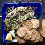 Low carb Loaded Greek Eggplant Dip is a Mediterranean style baba ganoush topped with kalamata olives, capers, and pine nuts #vegan #paleo #glutenfree #babaganoush #appetizer #eggplantdip #lowcarb
