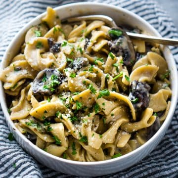 Mushroom stroganoff in white bowl with fork