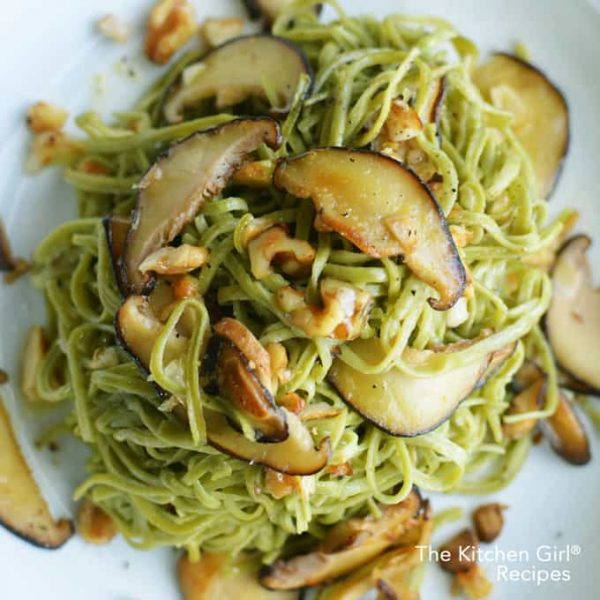 edamame pasta with mushrooms and walnuts on white plate