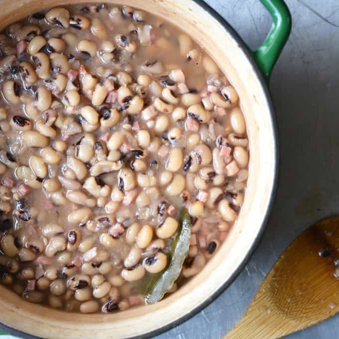 black eyed peas in cast iron dutch oven with wooden spoon