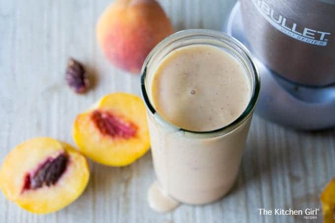 Peach NutriBullet Milkshake Without Ice Cream made with ice, peaches, and cream or vegan milk. Great smoothie for kids. Gluten free, no added sugar. thekitchengirl.com