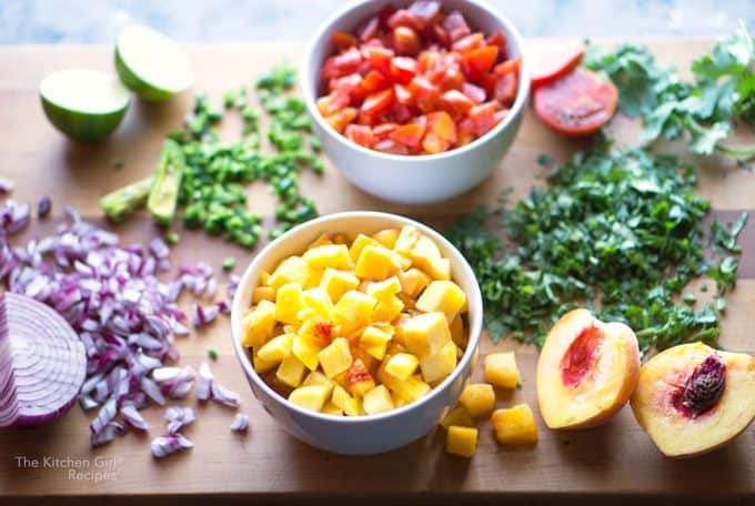 peach salsa ingredients chopped on a cutting board