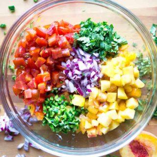 Raw, healthy, & so addictive! Peach Pico de Gallo Tomato Salsa quenches your thirst! on thekitchengirl.com #peachsalsa #peachrecipe #picodegallo #peachpicodegallo #cincodemayo #salsa #gardensalsa #healthymexican #paleo #vegan #glutenfree