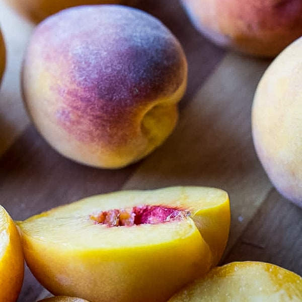 ripe whole peaches and pitted peach halves
