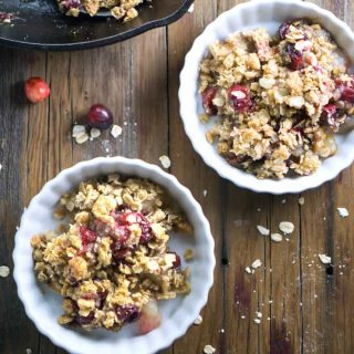 Secretly healthy holiday dessert! Scrumptious Pear Apple Cranberry Crisp is skillet baked with a crispy oat topping. #applecrisp #vegan #glutenfree #cranberries #holidaydessert #fruitcrisp #healthydessert