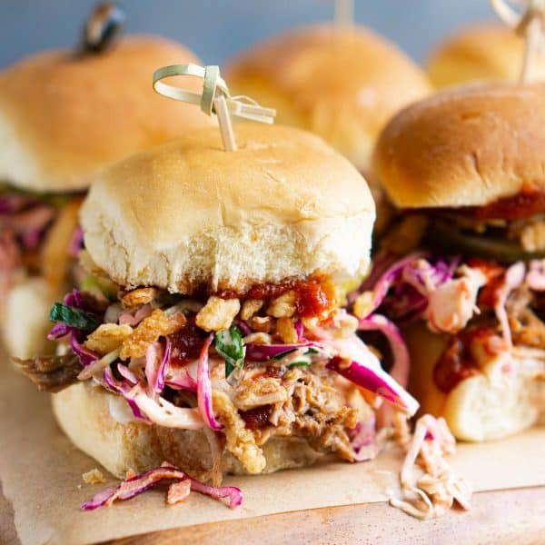 bbq pork sliders with coleslaw, French fried onions, pickles, and bbq sauce