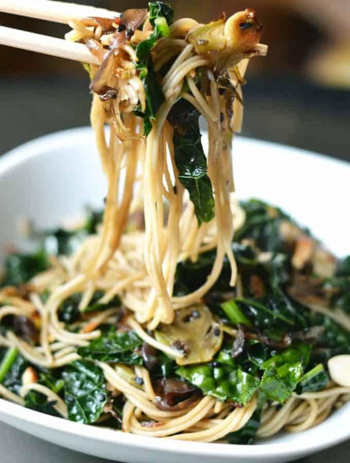 Healthy Asian noodles in 20 minutes! Sautéed Sesame Kale Noodles on thekitchengirl.com #vegan #vegannoodles #easydinnerrecipe #veganpasta #asianrecipe #glutenfreefriendly